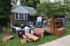 Flood-damaged contents of a home in west Baltimore. The neighborhoods of Beechfield, Irvington, and Westgate have been hit with three flash floods in 2018. (Anthony C. Hayes)