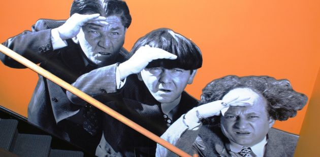 THree Stooges Shemp Howard, Moe Howard and Larry Fine. The art is from the back stairwell in the Stoogeum in Ambler, PA.