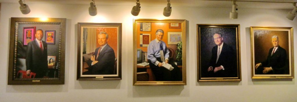 Portraits of past Howard County school superintendents hang in the Department of Education headquarters on Route 108. From right: John Yingling (1949-1968), M. Thomas Goedeke (1968-1984), Michael Hickey (1984-2000), John O'Rourke (2000-2004), and Sydney Cousin (2004-2012). Photo by Len Lazarick