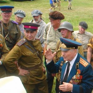 Soviet veteran Nikolai Zaitsev (right) shares his thoughts about war with reenactors at the 2016 MAAM WWII Weekend. (courtesy Svetlana Batrak)
