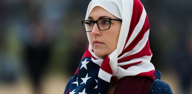 Inauguration Day: A woman wearing an American flag hijab on the Nation al Mall moments after the Inaugural ceremony concluded. The woman was unable to be identified. (Michael Jordan)