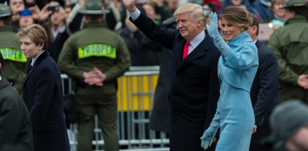 Inauguration Day: President and Mrs Trump wave to the crowd moments after exiting their vehicle to walk Past the Trump Hotel. This photo was taken at Pennsylvania Ave and 10th St NW. (Michael Jordan)