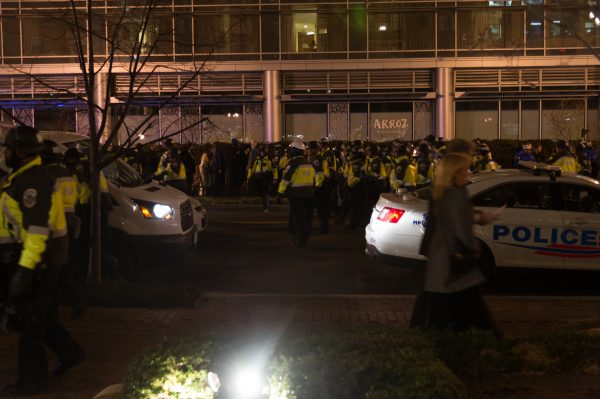 Police in riot formation push back unruly protestors who just charged the lobby of the Marriott Hotel across from the Henley Park Hotel. Michael Jordan)