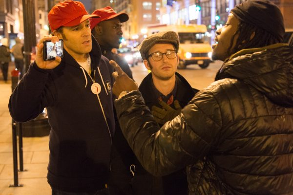 Arguing about dissenting opinions a Trump supporter holds his phone up to show the other man something. (Michael Jordan)