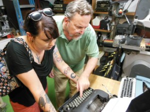 John Moore points out the features of a vintage Remington to writer Kat Malone.  (Anthony C. Hayes)