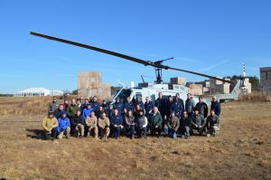 "Autonomous control: Flight Sciences team pose in front of the AACUS-enabled ""Huey"". (Anthony C. Hayes)"
