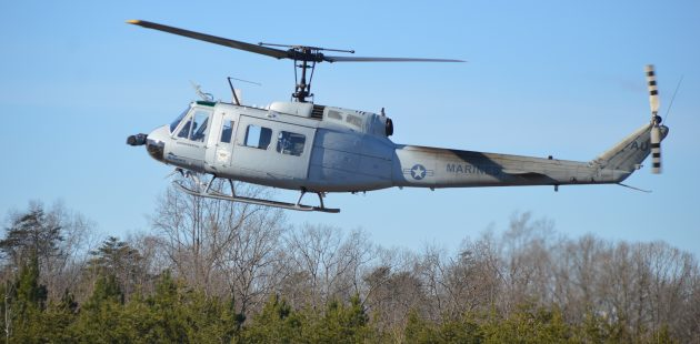 """Autonomous control: AACUS-Enabled Vietnam-era UH-1H """"Huey"""" negotiates a tree-line without a pilot at the controls. (Anthony C. Hayes)"""