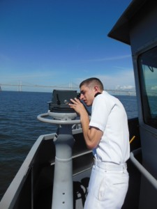 Midshipman carefully checks the ships bearings. (Anthony C. Hayes)