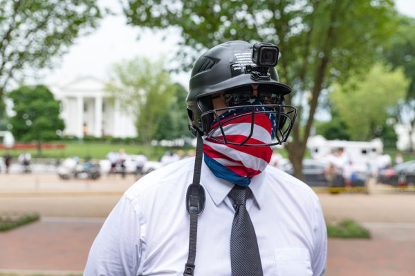 """Washington DC, Aug. 12, 2018: A helmet-clad protester from """"Unite the Right 2"""", quadrant at Lafayette Square just steps from the White House. There were less than two dozens """"Unite the Right 2"""" protesters. (Mike Jordan/BPE)"""