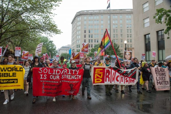 """Counter protesters march moments after the lackluster Aug. 12, 2018 """"Unite the Right 2"""" rally in Washington DC. (Mike Jordan/BPE)"""