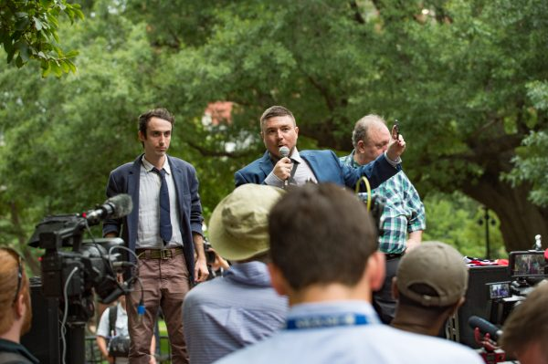 """""""Unite the Right 2"""" made up less than a few dozen people in their ultra secure zone on Lafayette Square. Journalists and Photographers vastly outnumbered the """"Unite the Right 2"""" protesters. Just across the square hundreds if not a thousand people gathered in counter protest. (Mike Jordan/BPE)"""