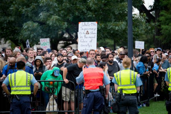 "Washington, DC. Aug 12, 2018: ""Unite the Right 2"" made up less than a few dozen people in their ultra secure zone on Lafayette Square. Journalists and Photographers vastly outnumbered the protesters in this areas. Just across the square perhaps a thousand people gathered in counter protest. (Mike Jordan/BPE)"