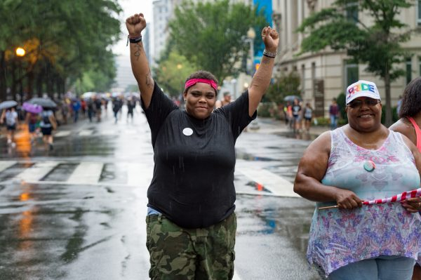 Washington, DC. Aug. 12, 2018: Kayla Williams, an anti-Unite the Right 2 protester, celebrates on H St. NW. (Mike Jordan/BPE)