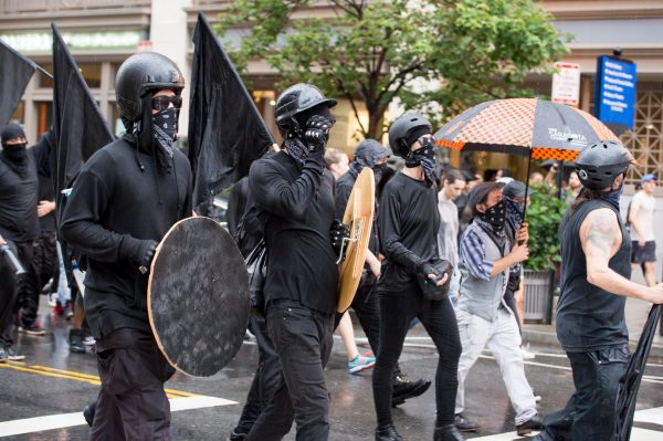 Washington, DC Aug 12, 2018: Anti-Unite the Right 2 protesters are seen marching with shields just moments before a violent clash with police on G St NW. in Washington, DC. (Mike Jordan/BPE)
