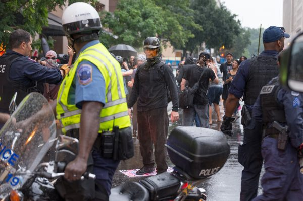Washington DC, Aug. 12, 2018: After refusing to stand back, an anti-Unite the Right 2 protester gets pepper sprayed during a violent clash with police on G St NW. Protesters threw objects, launched flares, stood on cars and pulled up trash cans. Police deployed pepper spray. (Mike Jordan/BPE)