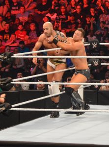 A dazed Cesaro is caught in the grasp of The Miz. (Anthony C. Hayes)