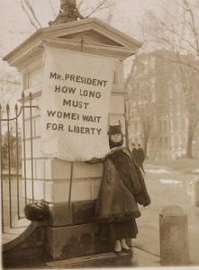 A suffragette protests outside the White House.