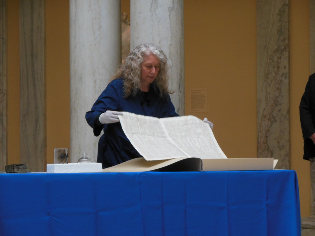 Terry Drayman-Weisser displays a pristine copy of the Federal Gazette. (Anthony C. Hayes)