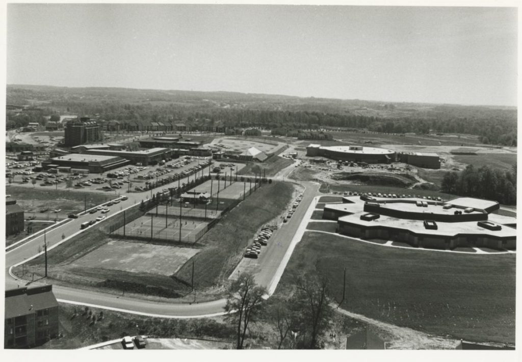 Wilde Lake Middle School, middle right, and Wilde Lake High School, upper right, were next to the village center. Morton Tadder photo. Courtesy of Columbia Archives