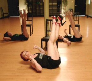 Towson studio members Rachael, Joanna and Chelsea stretch their legs as part of the chair workout. (Stacy Atwell)