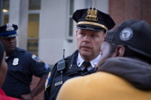 """Baltimore City police talk to protesters who were marching in support of """"Justice for Freddie Gray."""" (Erik Hoffman)"""