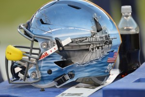 "Keenan Reynolds, as well as the rest of Navy's quarterbacks, wore a helmet with an aircraft carrier because the vessel because it's ""the quarterback of the Naval fleet, the aircraft carrier is the ultimate decision maker; the 'quick strike' weapon of the Naval fleet,"" according to the Navy."
