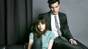 This is one of the few times Dakota Johnson and Jamie Dornan are clothed in Fifty Shades of Grey. (Universal Studios)