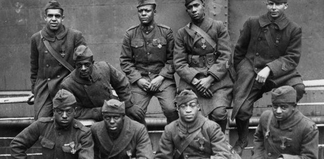 "A group of decorated soldiers from the famed ""Harlem Hellfighters"" proudly display the French Croix de guerre. Questions have long been raised as to why minority servicemen were denied the Medal of Honor. (Public Domain)"