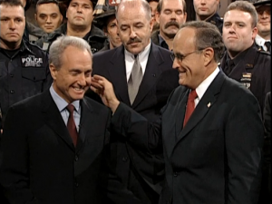 """Why start now?"": Mayor Giuliani and SNL's Lorne Michaels share a cathartic and symbolic laugh (screenshot from NBC.com)"