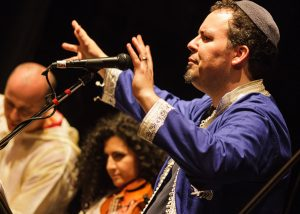 """Sephardic singer Sam Thomas with his New York Andalus Ensemble at """"Young Traditionalists: Rocking Their Roots"""" at the Brooklyn Music School, for """"The Sweetest Song Festival"""" with Brooklyn Arts Council. (Photo by Anna Mulé."""