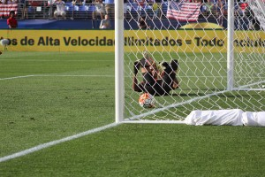 Cuba goalie Diosvelis Guerra watches helplessly after Clint Dempsey converts a penalty kick in the U.S.'s 6-0 win on Saturday. (Costa Swanson)