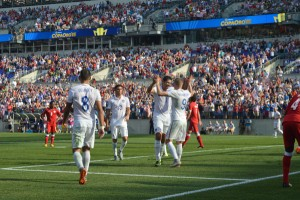 Aron Johannsson, right, and Omar Gonzalez celebrate after Gonzalez's goal late in the first half gave the U.S. a 4-0 lead. (Costa Swanson)